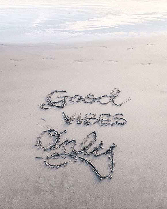 Beach with Good Vibes Only Written in the Sand