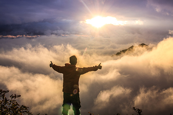 Man Standing Above Clouds