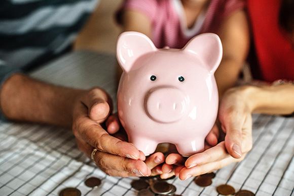 Pink Piggy Bank in hands
