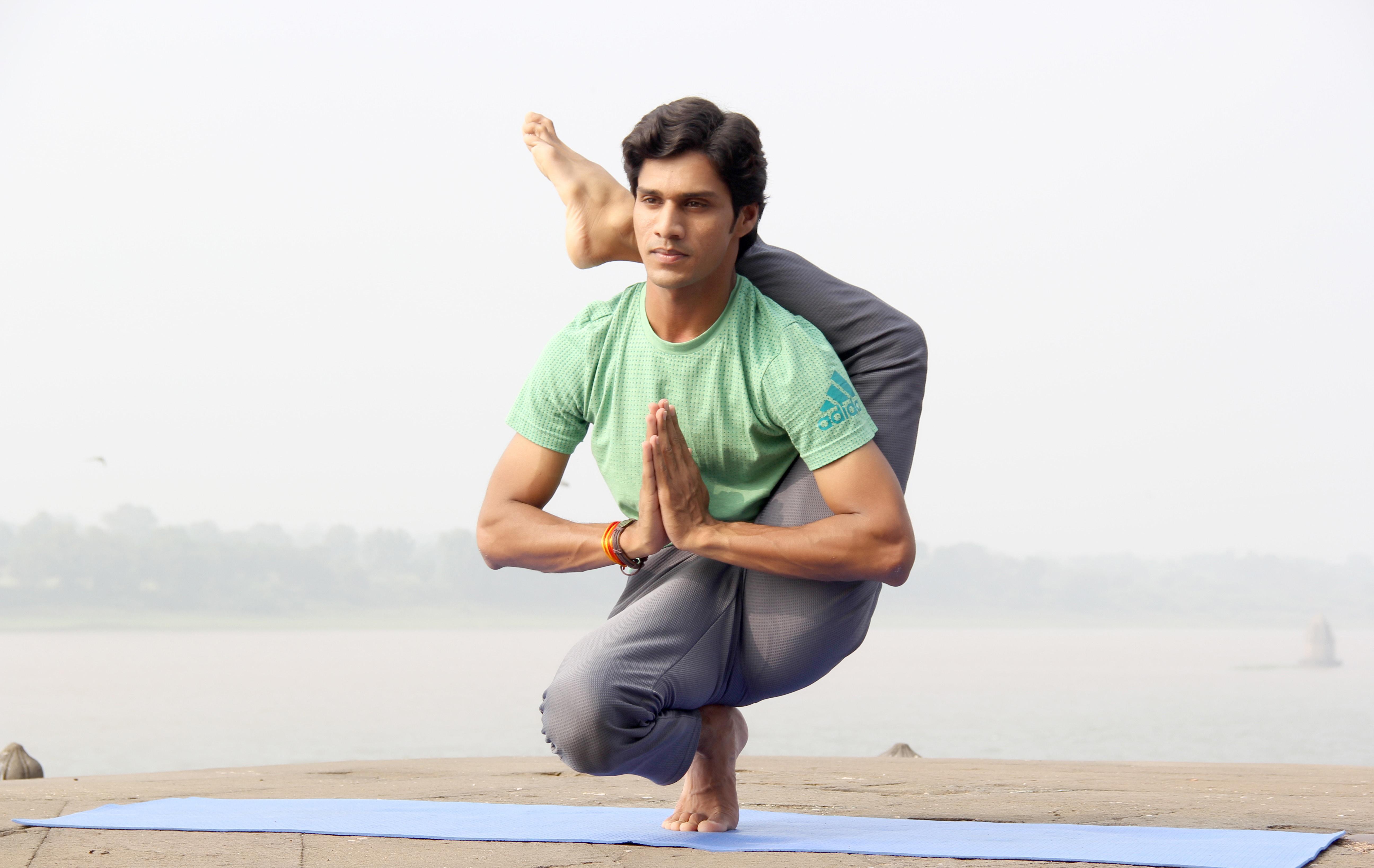 Man in Extreme Yoga Pose