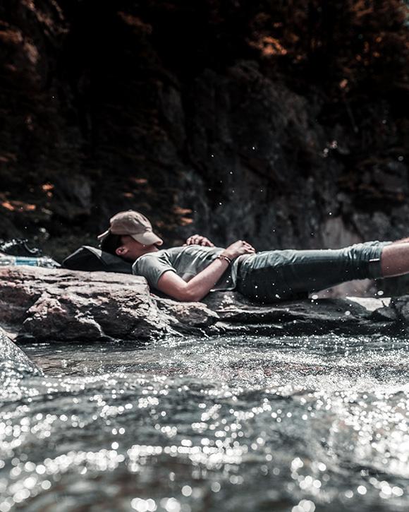 Man sleeping in stream