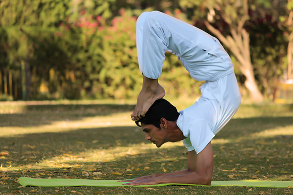 man doing yoga stretch