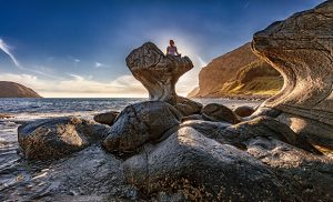 person meditating on a beautiful rock formation