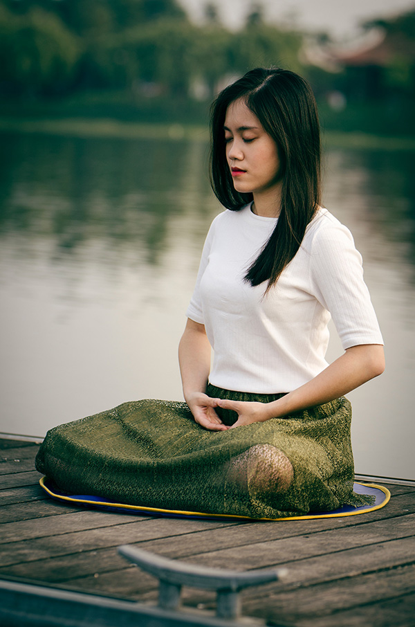 Woman Seated Yoga Style Breathing