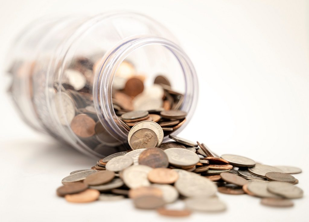 Tipped Over Jar of Coins
