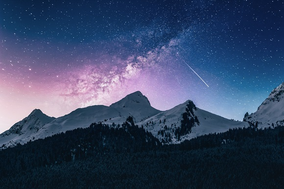Snow Capped Mountain Range With Falling Star