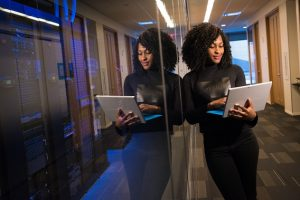 Woman with laptop mirror imaged double