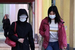 Two Women Walking in Medical Masks