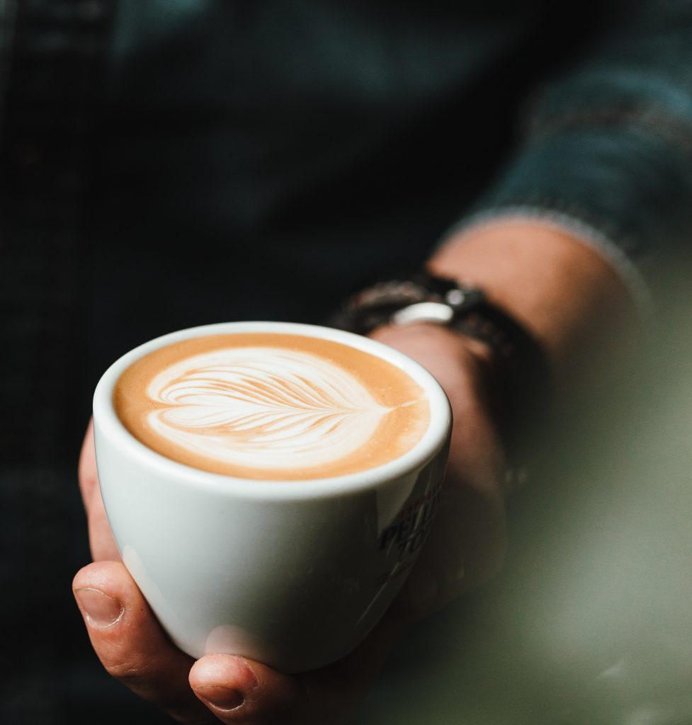 Cup Of Coffee With Artful Color in Hand