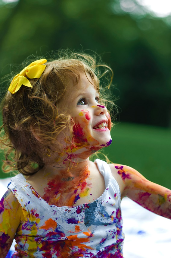 Little Girl Smiling Paint All Over