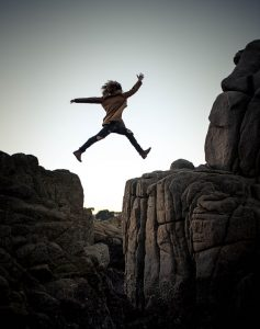Woman Jumping From Cliff to Cliff