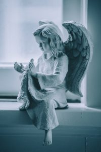 Angel Statue Holding A Dove