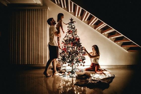 TriplePLife Couple and Child Decorating Christmas Tree