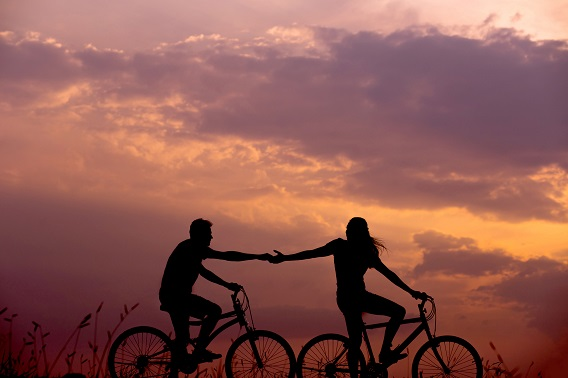 Bikers holding hands
