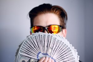 Guy Holding Cash With Sunglasses