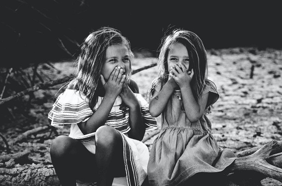 Two Little Girls Laughing