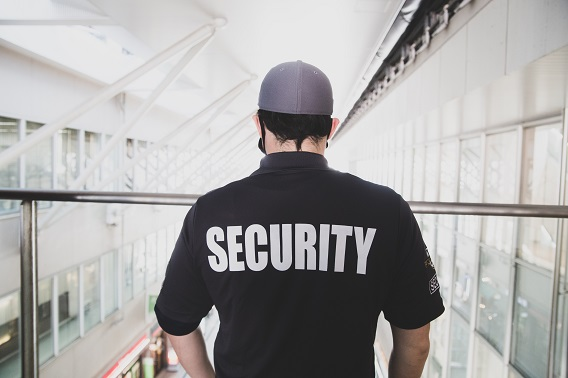 Man With Security On Back Of Shirt